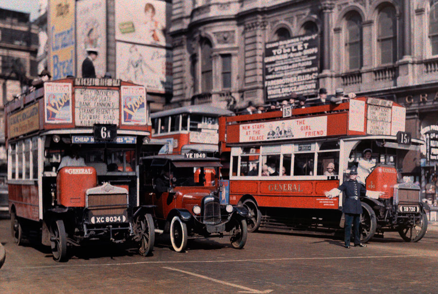 A policeman directs buses in the intersection of Trafalgar Square in London, May 1929.