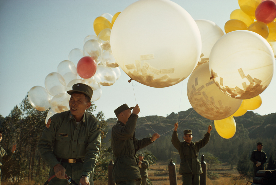 To spread political views, soldiers release balloons holding leaflets in Taiwan, January 1969.