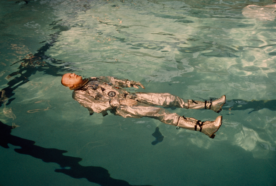 Astronaut Neil Armstrong floats in his space suit in a pool of water in 1967.