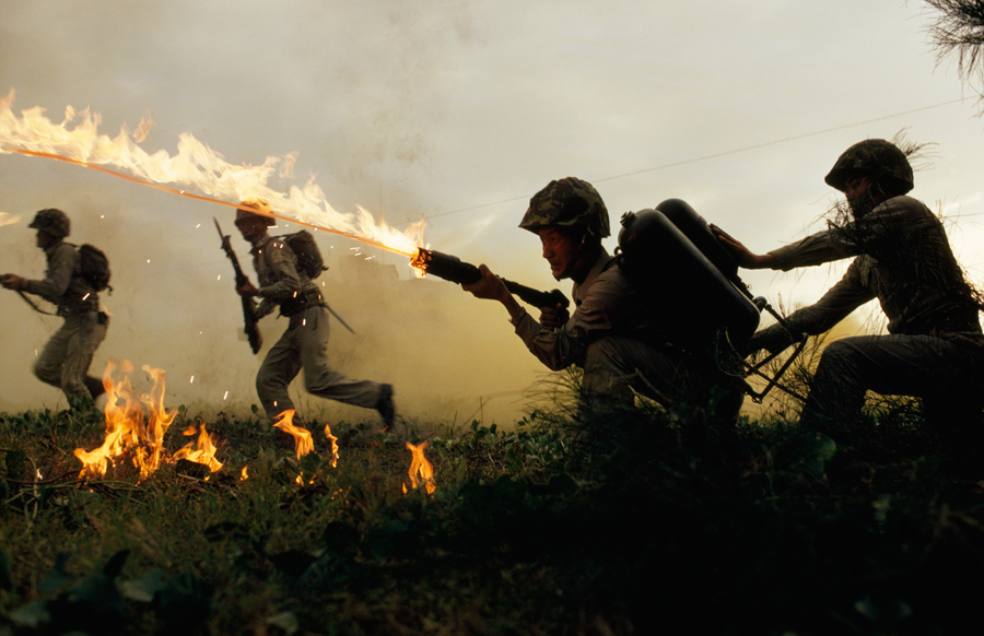 Marine infantry in Taiwan practice using flame throwers in a simulated battle, January 1969.