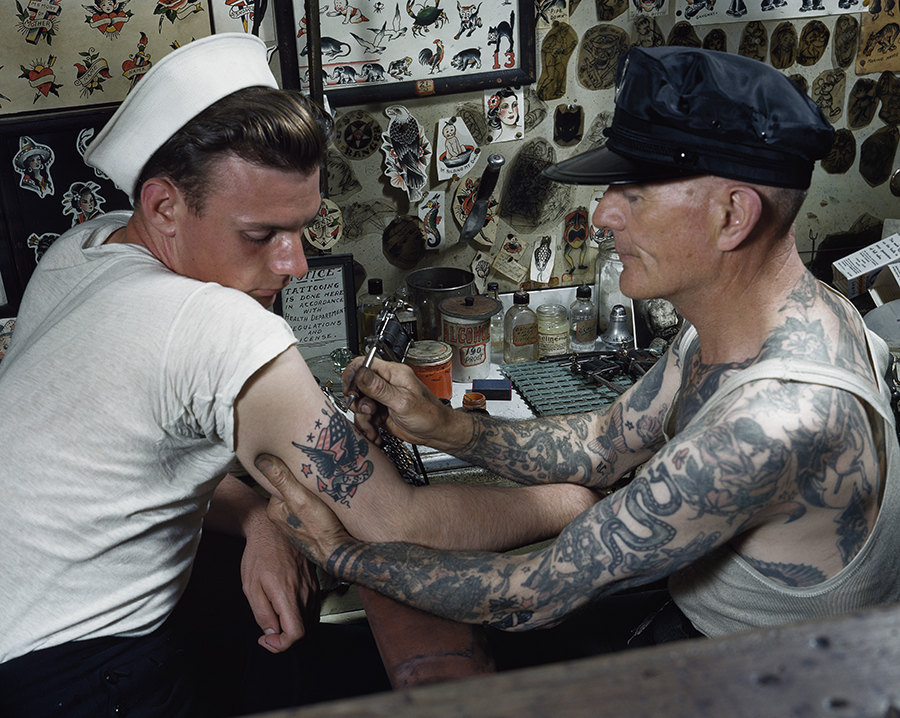 A sailor gets a tattoo on his arm in Virginia.