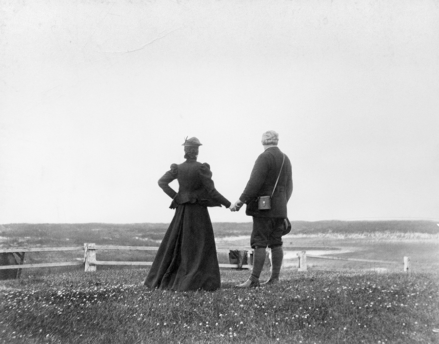 Alexander Graham Bell and his wife Mabel hold hands at the water's edge in Nova Scotia in 1898.